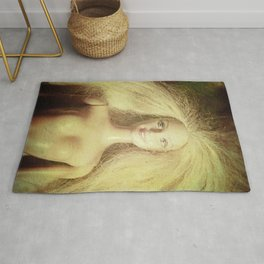 The old doll now is the new doll of a little girl Rug