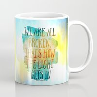 hemingway Mugs featuring We are All Broken Ernest Hemingway Quote by Ginkelmier