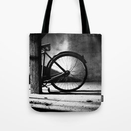 Old bicycle in a dusty attic Tote Bag
