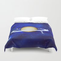saturn Duvet Covers featuring saturn playground. by Nancy Woland