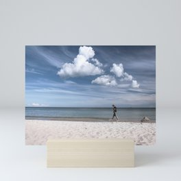 Lonely man at the beach Mini Art Print