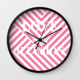 ' Love is an illusion ' on pink pattern Wall Clock