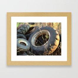 Old farm tires Framed Art Print