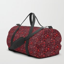 Hearts and flowers on a red background Duffle Bag