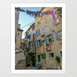 Little alley in the medieval center of the village Rovinji at sunset Art Print