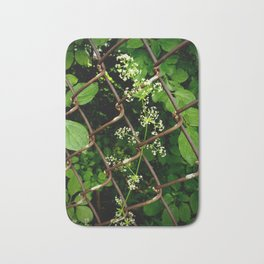 Flowers in the Chainlink Fence Bath Mat