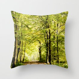 A pathway covered by leaves in a magical forest Throw Pillow