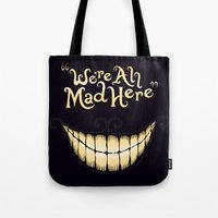 typography Tote Bags featuring We're All Mad Here by greckler