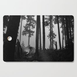 Mountain Biker in the Misty Bike Park Cutting Board