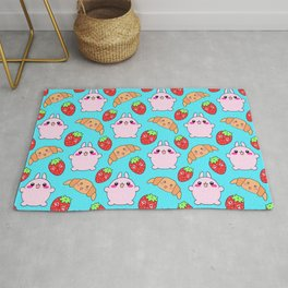 Cute happy funny pink baby bunnies, sweet adorable yummy Kawaii croissants and red ripe summer strawberries cartoon light pastel blue pattern design Rug
