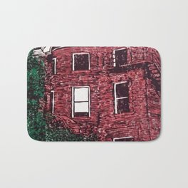 red brick house obstructed by trees linocut Bath Mat