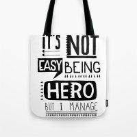 hero Tote Bags featuring hero by ulas okuyucu