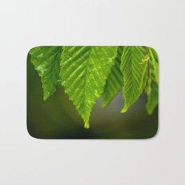 Waterdrops on a leaf Bath Mat