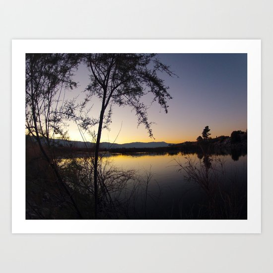 Sunset by the waters edge. Art Print