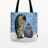 penguins Tote Bags featuring Emperor Penguins by Ben Geiger