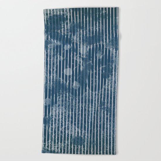 White stripes on grunge textured blue background Beach Towel
