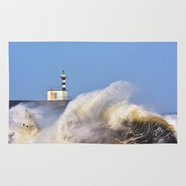 Stormy wave over lighthouse of San Esteban de Pravia. Rug