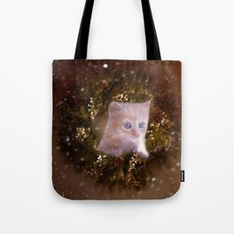 Christmas kitten watching the snow Tote Bag