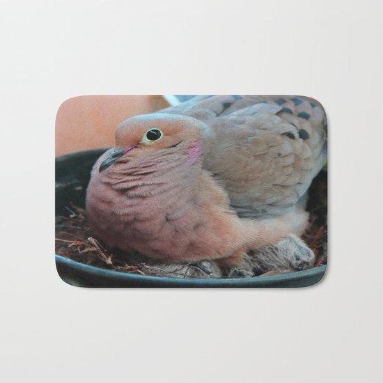 Baby Bird Peeking out at the World Bath Mat