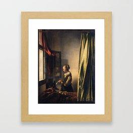 Johannes Vermeer - Girl reading a letter by an open window Framed Art Print