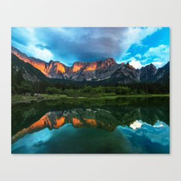 Burning sunset over the mountains at lake Fusine, Italy Canvas Print