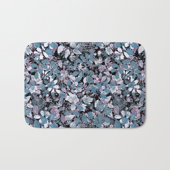 Openwork blue and purple leaves on a black background . Bath Mat