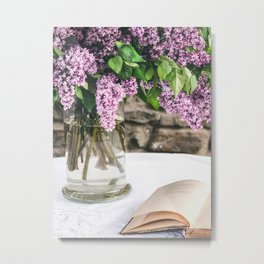 Romantic photo composition with lilac and vintage book on white lace tablecloth. Metal Print