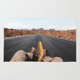 on the road in the monument valley Rug
