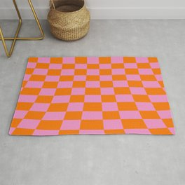 Warped perspective coloured checker board effect grid illustration orange and pink Rug