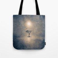 the shining Tote Bags featuring shining by Viviana Gonzalez
