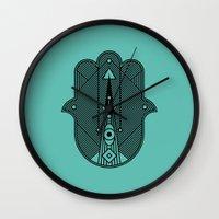 hamsa Wall Clocks featuring hamsa  by Leandro Pita