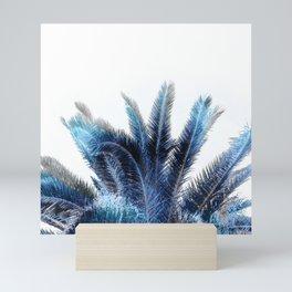 Blue Pam leaves on white Mini Art Print