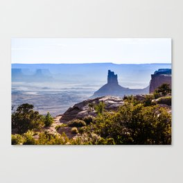 rocky butte at sunset in Utah badlands  Canvas Print
