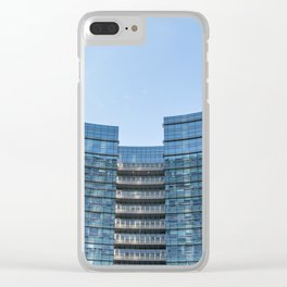 three workers work to clean the windows of a large skyscraper in Milan Clear iPhone Case