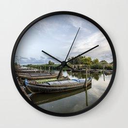 Boats in a lagoon port Wall Clock