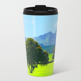 green tree in the green field with green mountain and blue sky background Travel Mug