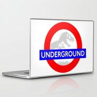 jurassic park Laptop & iPad Skins featuring LONDON UNDERGROUND : JURASSIC PARK SERVICE by DrakenStuff+
