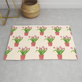 pink tulips in the pot Rug
