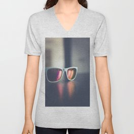 Sunglasses on a table Unisex V-Neck