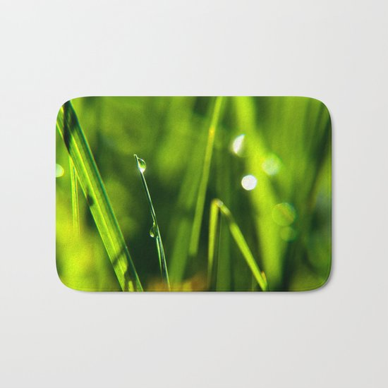 Dew on grass at early backlight Bath Mat