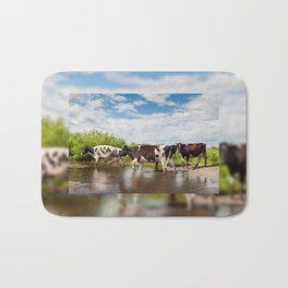Herd of cows walking across pool Bath Mat