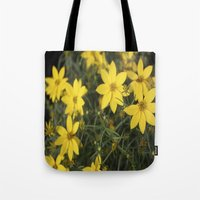 rileigh smirl Tote Bags featuring Yellow Flowers by Rileigh Smirl