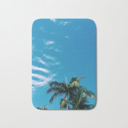 Byron Bay palm tree with complimentary clouds Bath Mat