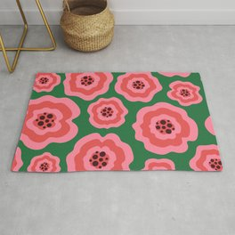 Pink liquid abstract flowers on green background Rug