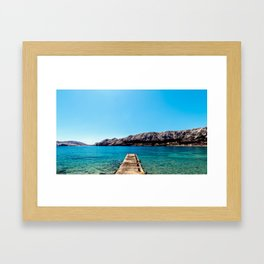 The bay of Baska in a sunny day Framed Art Print