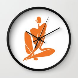 Sitting nude girl in orange Wall Clock