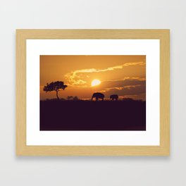 silhouettes of African elephants at sunset Framed Art Print