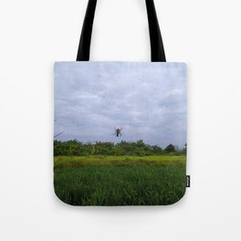 Hanging Spider over the field Tote Bag