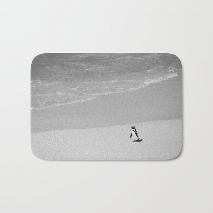 Lone African Penguin walking on beach Bath Mat