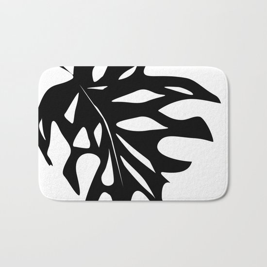 Black leaf monstera on white background . Bath Mat